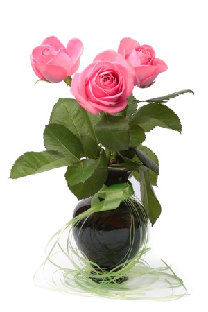 Three roses in ceramic vase photo