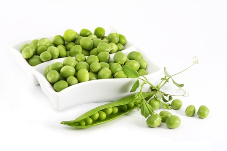 Fresh green peas and struchek on a light background  photo