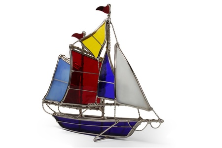 Model sailboat made of glass, isolated on a white background Stock Photo