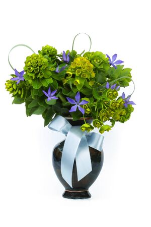 Flowers in a ceramic vase isolated on white background photo