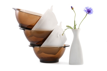 Glassware and vase with a flower on a white background photo