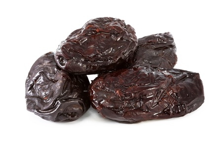 Dried plums are black isolated on a white background Stock Photo