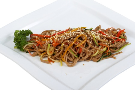 Buckwheat pasta with vegetables, parsley and sesame seeds