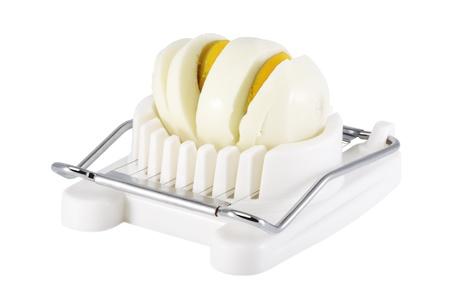 slicer: Sliced hard boiled eggs cut in Egg slicer, isolated