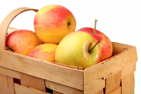 bushel: Apples in a basket on a white background