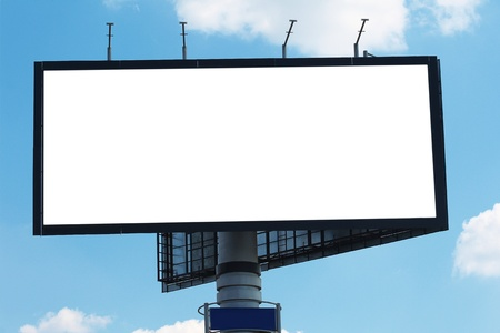Billboard against blue cloudy sky, in the street by day photo