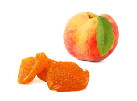 Dried fruit and ripe peach on a white background photo
