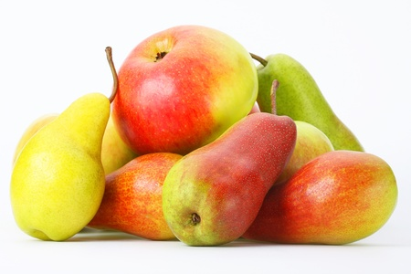 Fresh pears and apples on a light background