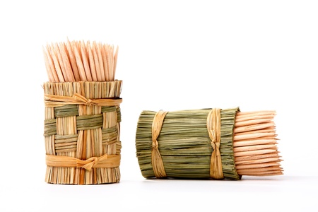 wooden toothpicks in a stand of straw on a light background Stock Photo - 10782502