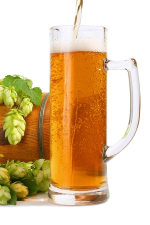 Plant hops, keg and a glass of beer isolated on white background photo