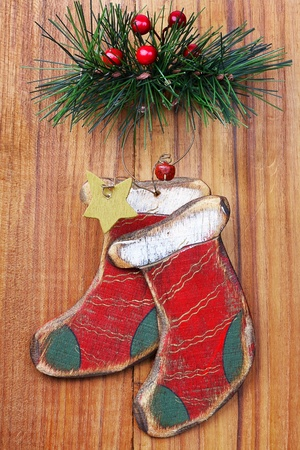 old Christmas ornaments on a wooden board photo