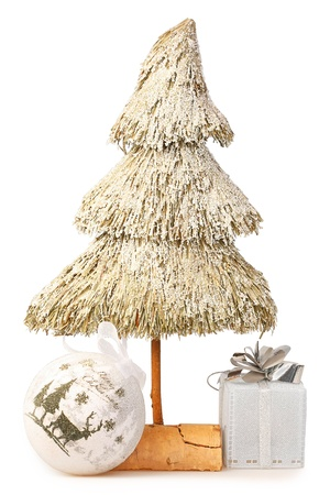 Christmas tree made of straw and Christmas baubles photo