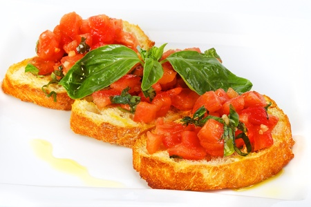 bruschetta: French toast with tomatoes Bruschetta (Italian Toasted Garlic Bread) with tomato