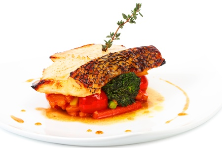 fried fish with sauce and vegetables photo