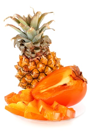 half stuff: Fresh fruits and persimmon pineapple cut into slices Stock Photo