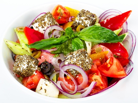 Greek salad - chopped fresh vegetables, olives, feta cheese, spices and olive oil photo