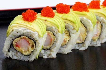 Sushi on a black tray