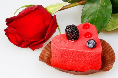 Cake with berries, blackberries and red rose photo