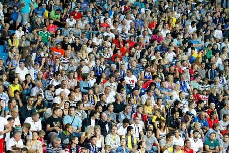 ODESSA, UKRAINE - AUGUST 19, 2012  People watch the football game of Ukraine Championship between miners and Chernomorets Odessa August 19, 2012 in Odessa, Ukraine