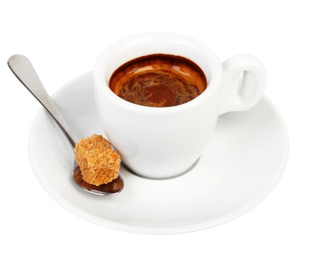 Coffee on a saucer and a spoon with a piece of cane sugar photo