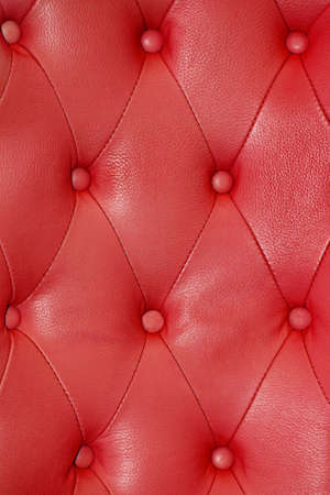Texture sofa upholstery in red leather photo
