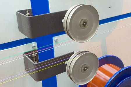Metal rollers with taut wire optical fiber photo