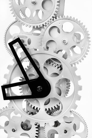 Part of gears in a mechanical clock on a light background photo