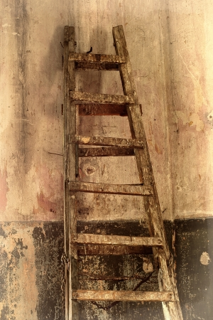 dilapidated: Dirty old staircase in the room with the old dilapidated walls.