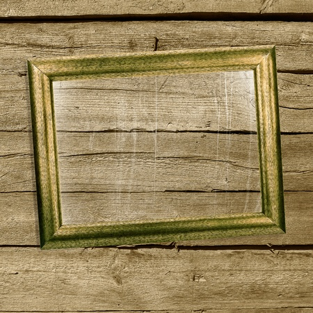 Old picture frames with scratched glass on grunge wooden wall Stock Photo - 17335779