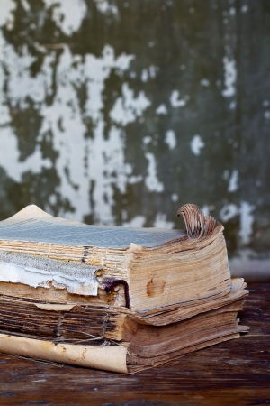 decrepitude: Vintage books on a wooden surface, sepia  Stock Photo