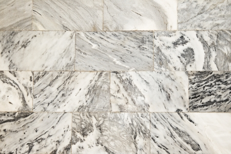 wall of the building of pale marble, grunge background Stock Photo