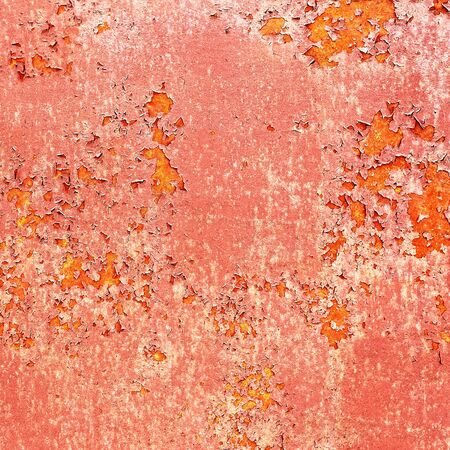Background of old metal painted red with traces of rust and paint photo