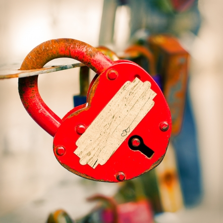 Red metal lock Key from heart of love, vintage background photo