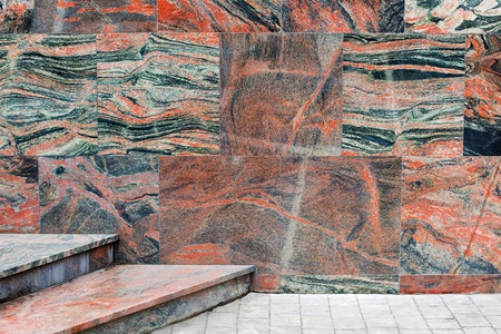 Wall and stairs covered with marble tiles photo