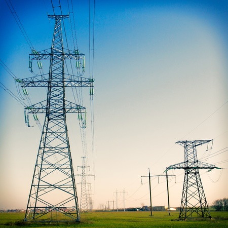 Super wide angle photograph of a row of power lines against a blue sky  Vintage Stock Photo