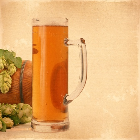 Vintage background with flowers and a glass of beer hops texture for any of your design  photo
