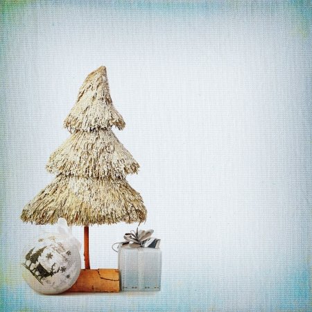 Christmas Tree and Christmas bauble on background of the old textured fabric photo