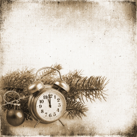 Christmas tree and an old clock on the background of the old textured fabric  photo