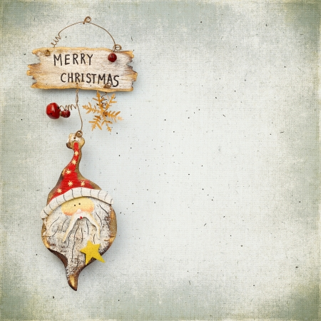 Christmas bauble on background of the old vintage textured fabric photo