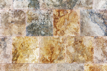 Creative textured background wall of marble tiles photo