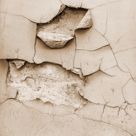 Old grungy wall texture. Peeling stained surface background.