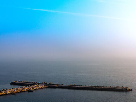cross processed: Fantastic beautiful sunset seascape with the horizon line disappears in the fog. Image shows a nice grain pattern at 100 percent Stock Photo