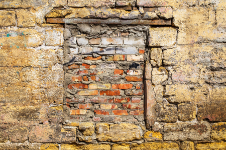 Vintage background old wall with a window laid bricks photo
