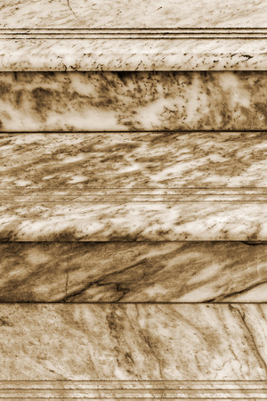 Old marble steps geometry in vintage sepia photo