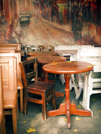 Chairs and table in the old cafe, vintage background  photo