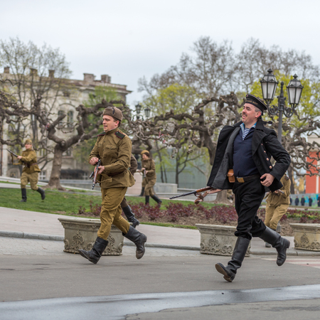 reproducing: ODESSA, UKRAINE - APRIL 10: Members of the military history of the club German and Russian soldiers in WW2 uniform. Historical military reproducing in Odessa Ukraine, April 10, 2014