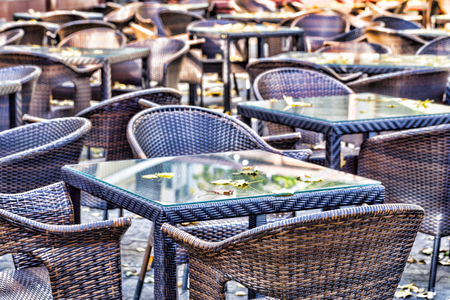 Empty autumn coffee terrace with tables and chairs. Odessa, Ukraine. Soft Focus   photo
