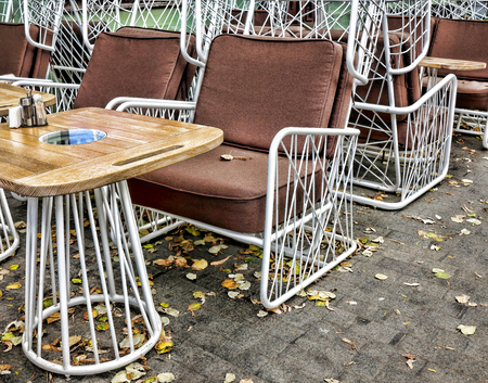 Empty autumn coffee terrace with tables and chairs. Odessa, Ukraine photo