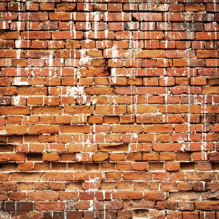 strong base: consistenza del vecchio muro di mattoni rossi Archivio Fotografico