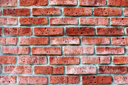 Texture laying walls of red brick of porous  Abstract